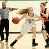 Niwot High School's Callie Hensen (No. 2) drives past Erie High School's Haley Gallagher (No. 32) during the first quarter, Friday, Nov. 30, 2012, at NHS.<br /> (Matthew Jonas/Times-Call)