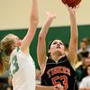 Erie High School's Piper Zeier (No. 53) puts up a shot over Niwot High School's Hannah Sarosi (No. 13) during the third quarter, Friday, Nov. 30, 2012, at NHS.<br /> (Matthew Jonas/Times-Call)