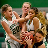 Erie High School's Amanda Ochoa (No. 10) tries to hang onto the rebound while surrounded by Niwot High School's Jaelyn Larson (No. 20) and Deyja Enriquez (No. 24) during the third quarter, Friday, Nov. 30, 2012, at NHS.<br /> (Matthew Jonas/Times-Call)