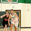 Niwot High School's Abbie Montgomery (No. 0) and Erie High School's Haley Gallagher (No. 32) chase down a loose ball during the second quarter, Friday, Nov. 30, 2012, at NHS. <br /> (Matthew Jonas/Times-Call)