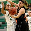 Niwot High School's Deyja Enriquez (No. 24) gets tangled up with Erie High School's Peiper Zeier (No. 53) during the fourth quarter, Friday, Nov. 30, 2012, at NHS. The Tigers defeated the Cougars, 39-36.<br /> (Matthew Jonas/Times-Call)