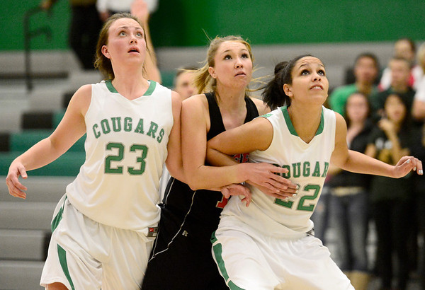 Niwot High School's Jacqui Sigg (No. 23) and Anessa Calvert (No. 22) try to box out Erie High School's Amanda Ochoa (No. 10) during the fourth quarter, Friday, Nov. 30, 2012, at NHS.<br /> (Matthew Jonas/Times-Call)