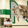 Niwot High School huddles before the start of the game against Erie High School, Friday, Nov. 30, 2012, at NHS. The Tigers defeated the Cougars, 39-36.<br /> (Matthew Jonas/Times-Call)