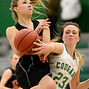 Niwot High School's Jacqui Sigg (No. 23) gets tangled up with Erie High School's Amanda Ochoa (No. 10) during the fourth quarter, Friday, Nov. 30, 2012, at NHS.<br /> (Matthew Jonas/Times-Call)