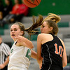 Niwot High School's Jaelyn Larson (No. 20) and Erie High School's Amanda Ochoa (No. 10) lose track of the ball while battling for control during the first quarter, Friday, Nov. 30, 2012, at NHS. <br /> (Matthew Jonas/Times-Call)