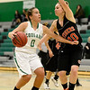 Niwot High School's Abbie Montgomery (No. 0) looks to drive past Erie High School's AManda Ochoa (No. 10) during the second quarter, Friday, Nov. 30, 2012, at NHS.<br /> (Matthew Jonas/Times-Call)