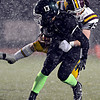 "Niwot's Nathan Merriman (13) is brought down by Windsor's Sean McAvoy (45) during the game at Everly-Montgomery Field on Thursday, Oct. 25, 2012.   Windsor beat Niwot 42-18.  For more photos visit  <a href=""http://www.BoCoPreps.com"">http://www.BoCoPreps.com</a>.<br /> (Greg Lindstrom/Times-Call)"