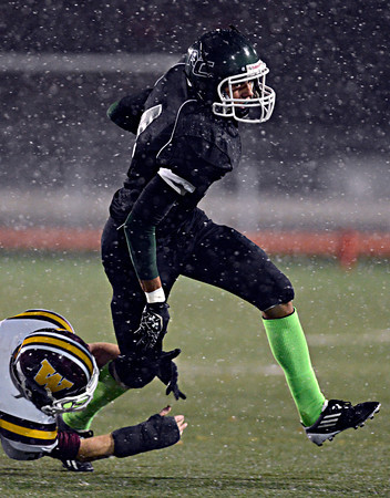 """Niwot's Forrest Lee breaks a tackle by Windsor's Alex Weis during the game at Everly-Montgomery Field on Thursday, Oct. 25, 2012.   Windsor beat Niwot 42-18.  For more photos visit  <a href=""""http://www.BoCoPreps.com"""">http://www.BoCoPreps.com</a>.<br /> (Greg Lindstrom/Times-Call)"""