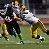 """Niwot's Elijah Noterman tries to run past Windsor's Brandon King and Alex Weis, right, during the game at Everly-Montgomery Field on Thursday, Oct. 25, 2012. For more photos visit  <a href=""""http://www.BoCoPreps.com"""">http://www.BoCoPreps.com</a>.<br /> (Greg Lindstrom/Times-Call)"""