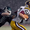 "Niwot's Jake Sarosi (10) tries to bring down Windsor's Brandon King (27) during the game at Everly-Montgomery Field on Thursday, Oct. 25, 2012.   Windsor beat Niwot 42-18.  For more photos visit  <a href=""http://www.BoCoPreps.com"">http://www.BoCoPreps.com</a>.<br /> (Greg Lindstrom/Times-Call)"