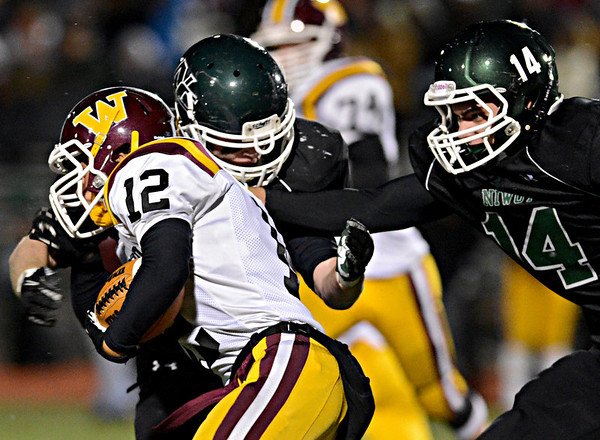 "Niwot's Cahill Kelleghan, right, and Jake Sarosi bring down Windsor's Devin Ferris (12) during the game at Everly-Montgomery Field on Thursday, Oct. 25, 2012. For more photos visit  <a href=""http://www.BoCoPreps.com"">http://www.BoCoPreps.com</a>.<br /> (Greg Lindstrom/Times-Call)"
