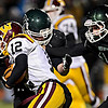 """Niwot's Cahill Kelleghan, right, and Jake Sarosi bring down Windsor's Devin Ferris (12) during the game at Everly-Montgomery Field on Thursday, Oct. 25, 2012. For more photos visit  <a href=""""http://www.BoCoPreps.com"""">http://www.BoCoPreps.com</a>.<br /> (Greg Lindstrom/Times-Call)"""