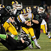 """Windsor's Joe Sanger, center, is brought down by Niwot's Bryan Meek (2), Danny Caruso (43) and Damian O'Hare (6) during the game at Everly-Montgomery Field on Thursday, Oct. 25, 2012.   Windsor beat Niwot 42-18.  For more photos visit  <a href=""""http://www.BoCoPreps.com"""">http://www.BoCoPreps.com</a>.<br /> (Greg Lindstrom/Times-Call)"""