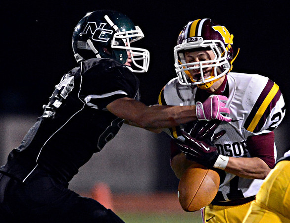 """Niwot's Elijah Noterman forces Windsor's Brandon King to fumble during the game at Everly-Montgomery Field on Thursday, Oct. 25, 2012.   Windsor beat Niwot 42-18.  For more photos visit  <a href=""""http://www.BoCoPreps.com"""">http://www.BoCoPreps.com</a>.<br /> (Greg Lindstrom/Times-Call)"""
