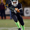 """Niwot's Lorne Jenkins runs for extra yards during the game at Everly-Montgomery Field on Thursday, Oct. 25, 2012.   Windsor beat Niwot 42-18.  For more photos visit  <a href=""""http://www.BoCoPreps.com"""">http://www.BoCoPreps.com</a>.<br /> (Greg Lindstrom/Times-Call)"""