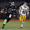 """Niwot's Nathan Merriman (13) tries to outrun Windsor's Sean McAvoy during the game at Everly-Montgomery Field on Thursday, Oct. 25, 2012. For more photos visit  <a href=""""http://www.BoCoPreps.com"""">http://www.BoCoPreps.com</a>.<br /> (Greg Lindstrom/Times-Call)"""