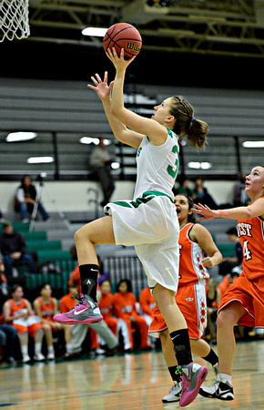 """Anna Dunnell (32) goes up for a shot over Denver West defenders during the game at Niwot High School on Friday, Dec. 7, 2012. Niwot won 44-33. For more photos visit  <a href=""""http://www.BoCoPreps.com"""">http://www.BoCoPreps.com</a>.<br /> (Greg Lindstrom/Times-Call)"""