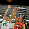"""Niwot's Juliet Pilewskie (25) tries to shoot over Denver West's Cassandra Copeland (4) during the game at Niwot High School on Friday, Dec. 7, 2012. Niwot won 44-33. For more photos visit  <a href=""""http://www.BoCoPreps.com"""">http://www.BoCoPreps.com</a>.<br /> (Greg Lindstrom/Times-Call)"""