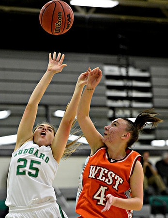 "Niwot's Juliet Pilewskie (25) tries to shoot over Denver West's Cassandra Copeland (4) during the game at Niwot High School on Friday, Dec. 7, 2012. Niwot won 44-33. For more photos visit  <a href=""http://www.BoCoPreps.com"">http://www.BoCoPreps.com</a>.<br /> (Greg Lindstrom/Times-Call)"