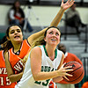 """Niwot's Jacqui Sigg looks to shoot over Denver West's Angelique Rivas during the game at Niwot High School on Friday, Dec. 7, 2012. For more photos visit  <a href=""""http://www.BoCoPreps.com"""">http://www.BoCoPreps.com</a>.<br /> (Greg Lindstrom/Times-Call)"""