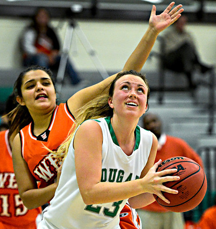 "Niwot's Jacqui Sigg looks to shoot over Denver West's Angelique Rivas during the game at Niwot High School on Friday, Dec. 7, 2012. For more photos visit  <a href=""http://www.BoCoPreps.com"">http://www.BoCoPreps.com</a>.<br /> (Greg Lindstrom/Times-Call)"