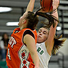 """Niwot's Jaelyn Larson pulls down a rebound over Denver West's Cassandra Copeland (4) during the game at Niwot High School on Friday, Dec. 7, 2012. Niwot won 44-33. For more photos visit  <a href=""""http://www.BoCoPreps.com"""">http://www.BoCoPreps.com</a>.<br /> (Greg Lindstrom/Times-Call)"""