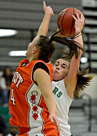 "Niwot's Jaelyn Larson pulls down a rebound over Denver West's Cassandra Copeland (4) during the game at Niwot High School on Friday, Dec. 7, 2012. Niwot won 44-33. For more photos visit  <a href=""http://www.BoCoPreps.com"">http://www.BoCoPreps.com</a>.<br /> (Greg Lindstrom/Times-Call)"