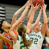 """Niwot's Anna Dunnell, right, grabs a rebound over Denver West's Cheana Gavin during the game at Niwot High School on Friday, Dec. 7, 2012. For more photos visit  <a href=""""http://www.BoCoPreps.com"""">http://www.BoCoPreps.com</a>.<br /> (Greg Lindstrom/Times-Call)"""