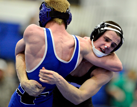 "Niwot's Joey Lambert, right, works against Longmont's Colten Montgomery during the dual meet at Longmont High School on Thursday, Jan. 31, 2013. For more photos visit  <a href=""http://www.BoCoPreps.com"">http://www.BoCoPreps.com</a>.<br /> (Greg Lindstrom/Times-Call)"