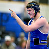 "Longmont's Ivan Wolf points to the team bench in celebration after defeating Niwot's David Voss during the dual meet at Longmont High School on Thursday, Jan. 31, 2013. For more photos visit  <a href=""http://www.BoCoPreps.com"">http://www.BoCoPreps.com</a>.<br /> (Greg Lindstrom/Times-Call)"