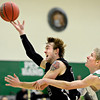"Silver Creek's Brock Johnson is fouled by Niwot's Kyle Kolakowski during the game at Niwot High School on Tuesday, Jan. 15, 2013. Silver Creek beat Niwot 68-55. For more photos from the game visit  <a href=""http://www.BoCoPreps.com"">http://www.BoCoPreps.com</a>.<br /> (Greg Lindstrom/Times-Call)"
