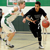 "Silver Creek's Trey Fleming, right, tries to drive past Niwot's Kyle Kolakowski during the game at Niwot High School on Tuesday, Jan. 15, 2013. Silver Creek beat Niwot 68-55. For more photos from the game visit  <a href=""http://www.BoCoPreps.com"">http://www.BoCoPreps.com</a>.<br /> (Greg Lindstrom/Times-Call)"
