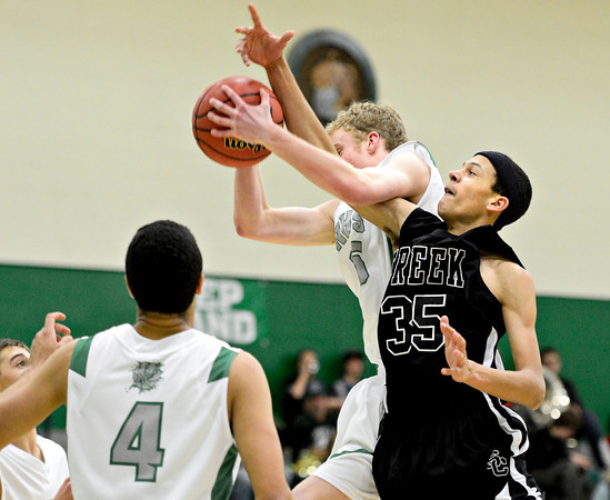 "Silver Creek's Jordan Wright (35) competes for a rebound against Niwot's Madison Bounds during the game at Niwot High School on Tuesday, Jan. 15, 2013. Silver Creek beat Niwot 68-55. For more photos from the game visit  <a href=""http://www.BoCoPreps.com"">http://www.BoCoPreps.com</a>.<br /> (Greg Lindstrom/Times-Call)"