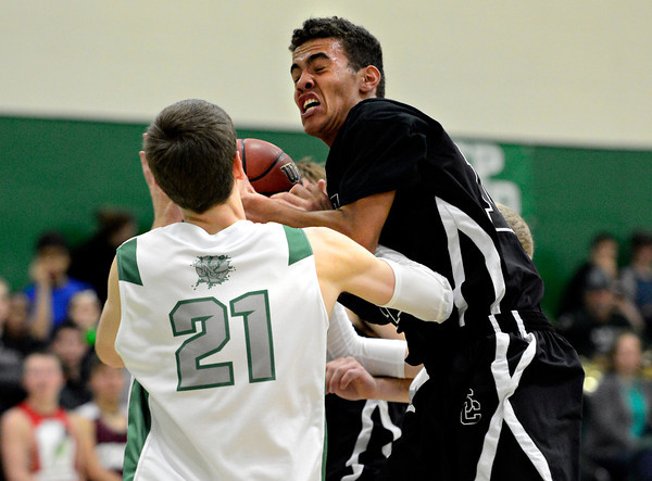 "Silver Creek's Trey Fleming, right, pulls down a rebound over Niwot's Clarke Colwell (21) during the game at Niwot High School on Tuesday, Jan. 15, 2013. Silver Creek beat Niwot 68-55. For more photos from the game visit  <a href=""http://www.BoCoPreps.com"">http://www.BoCoPreps.com</a>.<br /> (Greg Lindstrom/Times-Call)"