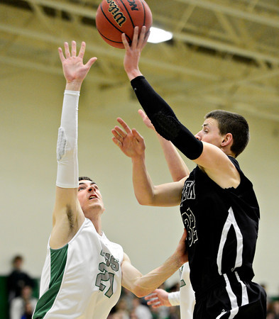 "Niwot's Clarke Colwell (21) tries to defend a shot by Silver Creek's Like Goforth (32) during the game at Niwot High School on Tuesday, Jan. 15, 2013. Silver Creek beat Niwot 68-55. For more photos from the game visit  <a href=""http://www.BoCoPreps.com"">http://www.BoCoPreps.com</a>.<br /> (Greg Lindstrom/Times-Call)"