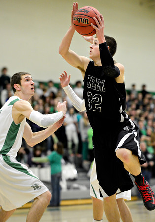 "Silver Creek's Luke Goforth (32) goes up for a shot during the game at Niwot High School on Tuesday, Jan. 15, 2013. Silver Creek beat Niwot 68-55. For more photos from the game visit  <a href=""http://www.BoCoPreps.com"">http://www.BoCoPreps.com</a>.<br /> (Greg Lindstrom/Times-Call)"