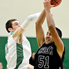 """Niwot's Clarke Colwell (21) competes for a rebound against Silver Creek's Josh Tarin (51) during the game at Niwot High School on Tuesday, Jan. 15, 2013. Silver Creek beat Niwot 68-55. For more photos from the game visit  <a href=""""http://www.BoCoPreps.com"""">http://www.BoCoPreps.com</a>.<br /> (Greg Lindstrom/Times-Call)"""