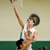 """Niwot's Jordan Keeler shoots over Silver Creek's Chico Grine (24) during the game at Niwot High School on Tuesday, Jan. 15, 2013. Silver Creek beat Niwot 68-55. For more photos from the game visit  <a href=""""http://www.BoCoPreps.com"""">http://www.BoCoPreps.com</a>.<br /> (Greg Lindstrom/Times-Call)"""