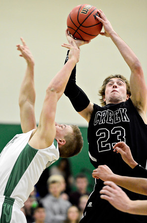 "Silver Creek's Brock Johnson (23) pulls down a rebound over Niwot's Nate Merriman during the game at Niwot High School on Tuesday, Jan. 15, 2013. Silver Creek beat Niwot 68-55. For more photos from the game visit  <a href=""http://www.BoCoPreps.com"">http://www.BoCoPreps.com</a>.<br /> (Greg Lindstrom/Times-Call)"