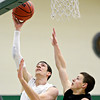 """Niwot's Clarke Colwell (21) shoots over Silver Creek's Luke Goforth (32) during the game at Niwot High School on Tuesday, Jan. 15, 2013. Silver Creek beat Niwot 68-55. For more photos from the game visit  <a href=""""http://www.BoCoPreps.com"""">http://www.BoCoPreps.com</a>.<br /> (Greg Lindstrom/Times-Call)"""