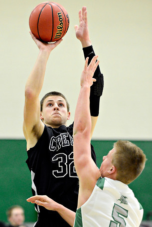 """Silver Creek's Luke Goforth (32) shoots over Niwot's Nate Merriman (5) during the game at Niwot High School on Tuesday, Jan. 15, 2013. Silver Creek beat Niwot 68-55. For more photos from the game visit  <a href=""""http://www.BoCoPreps.com"""">http://www.BoCoPreps.com</a>.<br /> (Greg Lindstrom/Times-Call)"""