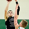 "Silver Creek's Luke Goforth (32) shoots over Niwot's Nate Merriman (5) during the game at Niwot High School on Tuesday, Jan. 15, 2013. Silver Creek beat Niwot 68-55. For more photos from the game visit  <a href=""http://www.BoCoPreps.com"">http://www.BoCoPreps.com</a>.<br /> (Greg Lindstrom/Times-Call)"