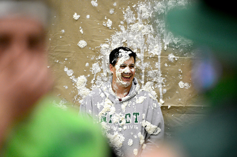 "Niwot Athletic Director Jim Butterfield laughs after being hit with whipped cream pies during halftime at the game at Niwot High School on Tuesday, Jan. 15, 2013. Silver Creek beat Niwot 68-55. For more photos from the game visit  <a href=""http://www.BoCoPreps.com"">http://www.BoCoPreps.com</a>.<br /> (Greg Lindstrom/Times-Call)"