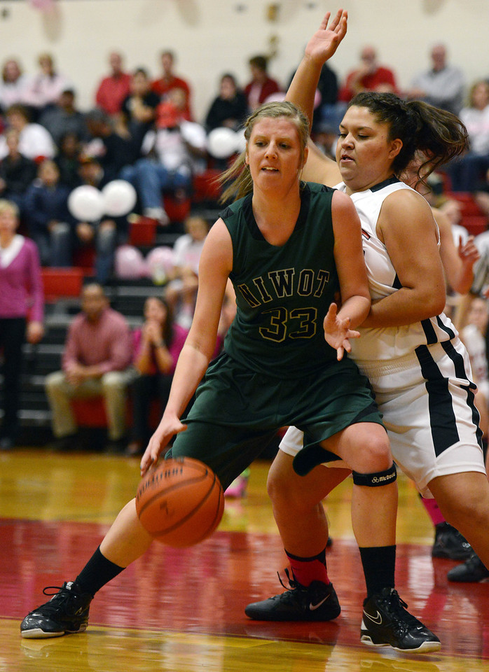 Niwot's Alicia Discipio drives against Skyline's Zenia Quintana in the second quarter Saturday night Dec. 15, 2012 at Skyline High School. (Lewis Geyer/Times-Call)