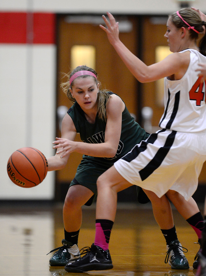 Niwot's Jaelyn Larson passes past Skyline's Carissa Curtis in the first quarter Saturday Dec. 15, 2012 at Skyline High School.(Lewis Geyer/Times-Call)