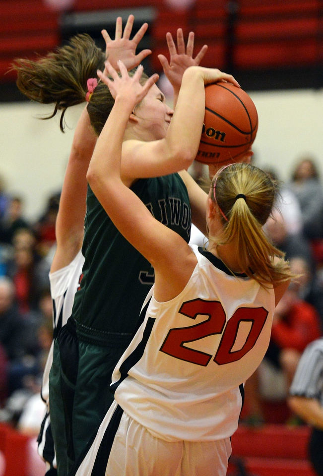 Niwot's Anna Dunnell is covered by Skyline defenders in the second quarter Saturday night Dec. 15, 2012 at Skyline High School.(Lewis Geyer/Times-Call)