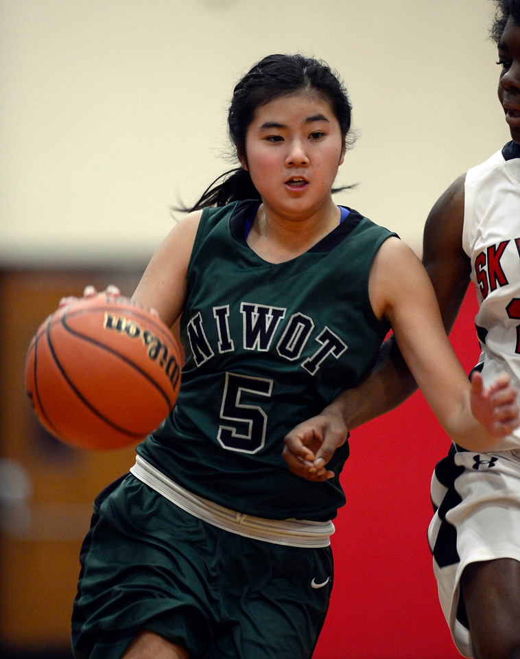 Niwot's Cindy Yie brings the ball down court against Skyline in the first quarter Saturday Dec. 15, 2012 at Skyline High School.(Lewis Geyer/Times-Call)
