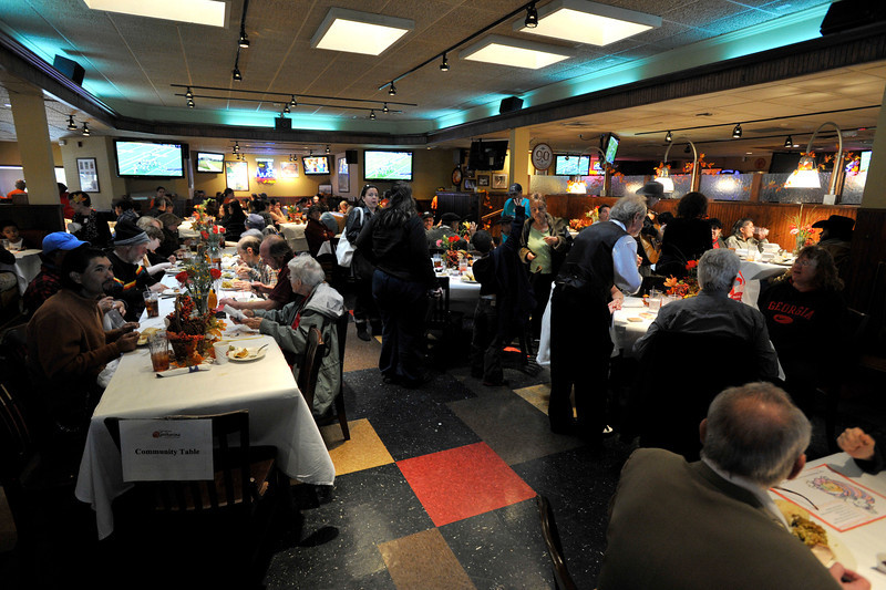 A nearly full dining room is seen during the OUR Center's annual Thanksgiving Day dinner, Thursday, Nov. 22, 2012, at Old Chicago in Longmont.<br /> (Matthew Jonas/Times-Call)