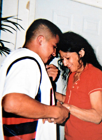 "Anthony Cruz Sandoval-Palma, left, dances with his mother, Alicia Palma, in the family's Longmont home. Adolph Lopez was the driver involved in a Feb. 25, 2012 car crash near Hygiene that left two men dead, including Anthony Cruz Sandoval-Palma. Lopez pleaded guilty to one count of DUI-related vehicular homicide in December and was sentenced Monday to six years in community corrections. The family of Sandoval-Palma believes the sentence was too lenient. For more photos and a video, visit  <a href=""http://www.TimesCall.com"">http://www.TimesCall.com</a>. (Greg Lindstrom/Times-Call)"