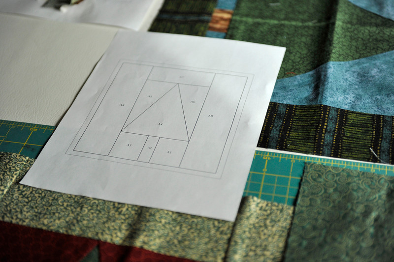 A diagram of the design for a pillow is seen next to completed panels , Thursday, Nov. 15, 2012, at Michelle-Nicholle Calareso's home in Longmont.<br /> (Matthew Jonas/Times-Call)